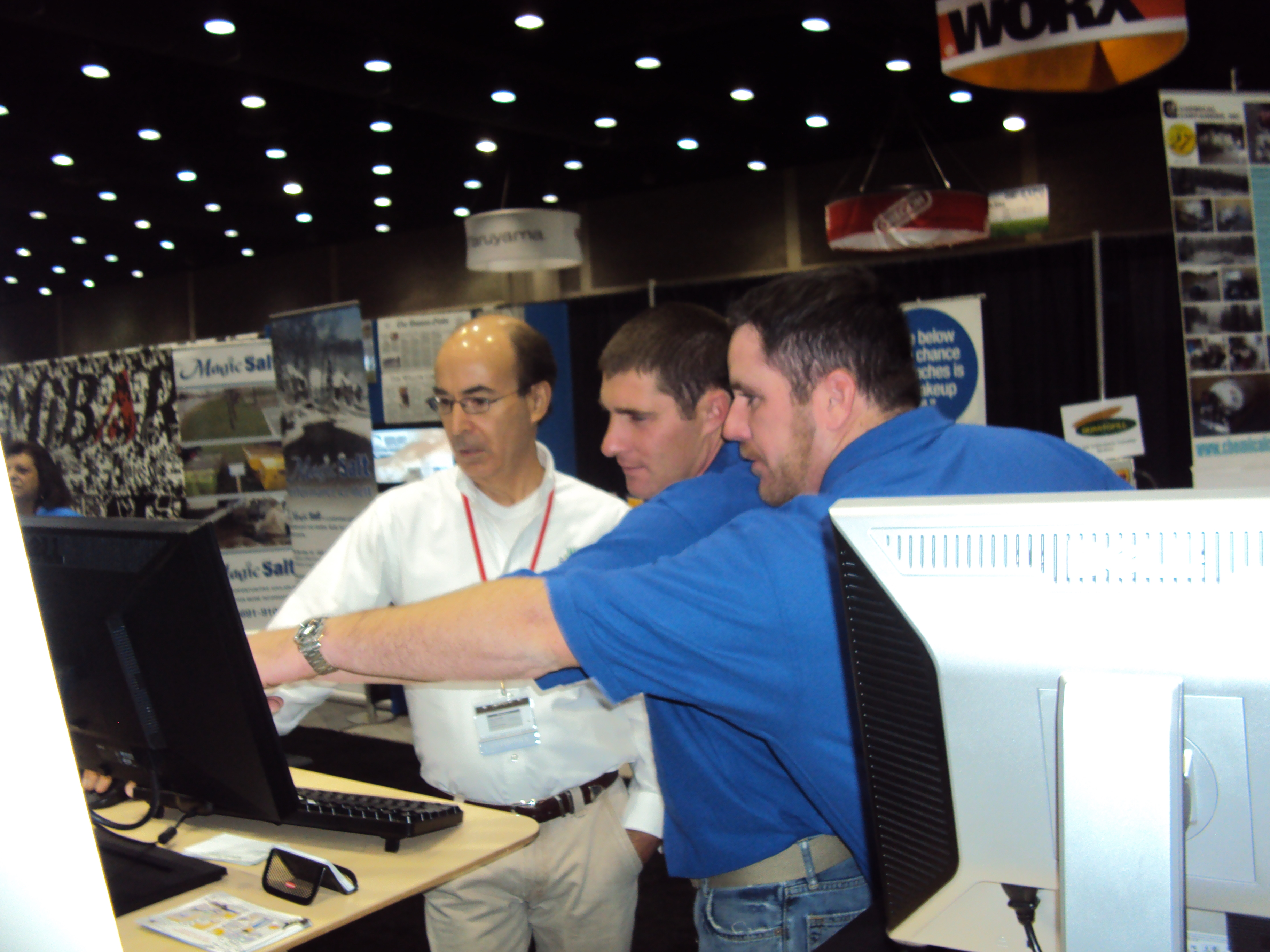 Chris Ascolese demonstrating Go iLawn to booth visitors at GIE+EXPO.