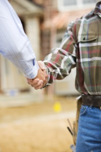 Subcontractor and owner shaking hands